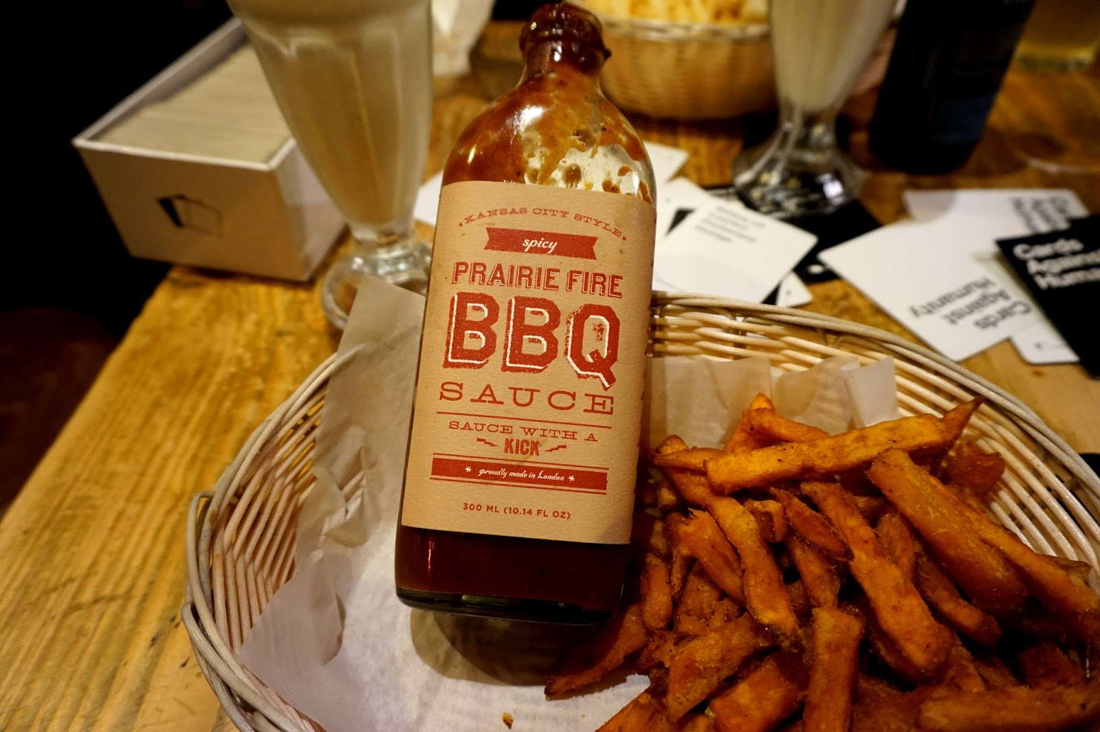 "<img src=""tommis burger joint kings road.jpg"" alt=""sweet potato fries and bbq sauce"" />"