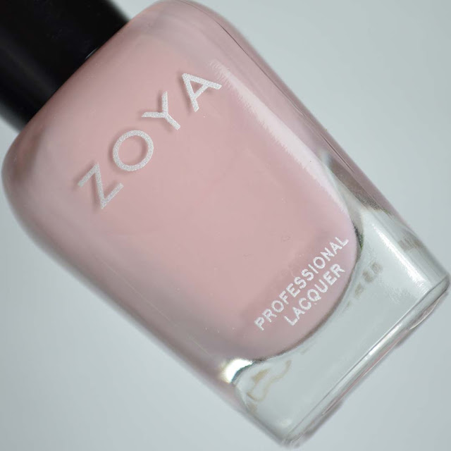 taupe mauve creme nail polish in a bottle