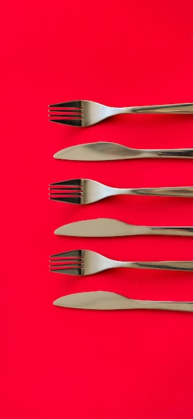 Cutlery on red table wallpaper