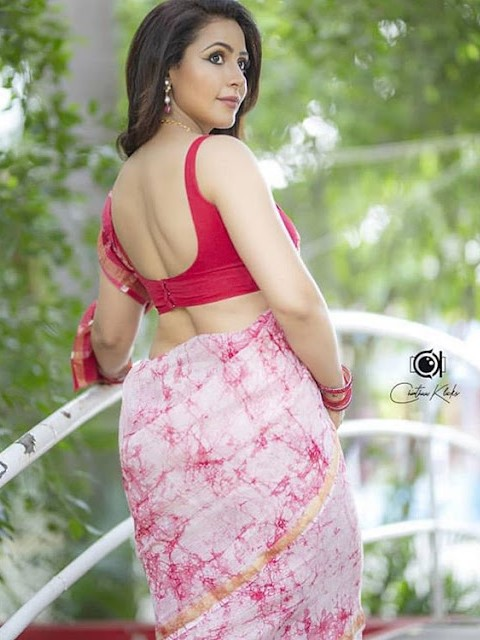 Nandini Rai poses for a sultry picture in a Bra saree Navel Queens