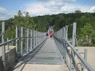 People Crossing Ranney Gorge Suspension Bridge.