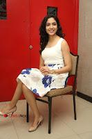 Actress Ritu Varma Stills in White Floral Short Dress at Kesava Movie Success Meet .COM 0225.JPG