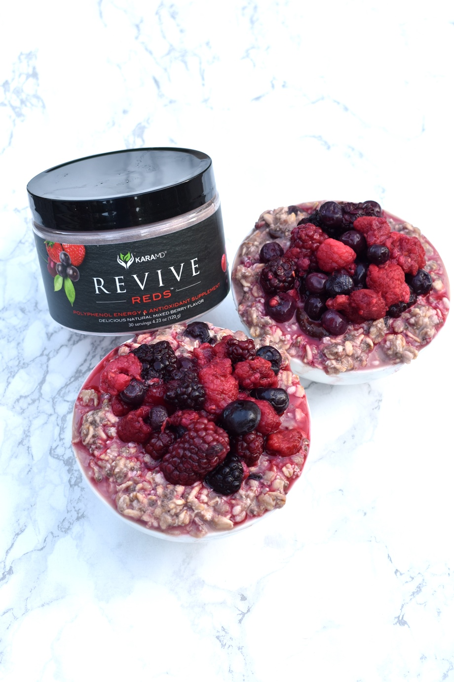 2 bowls of oatmeal topped with berries