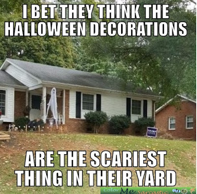 Home with Halloween decorations and Trump sign in the yard