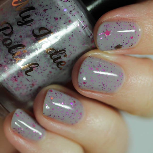 grey nail polish with berry pink glitters and star glitters