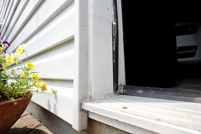 finished door stop framing patch on garage man door