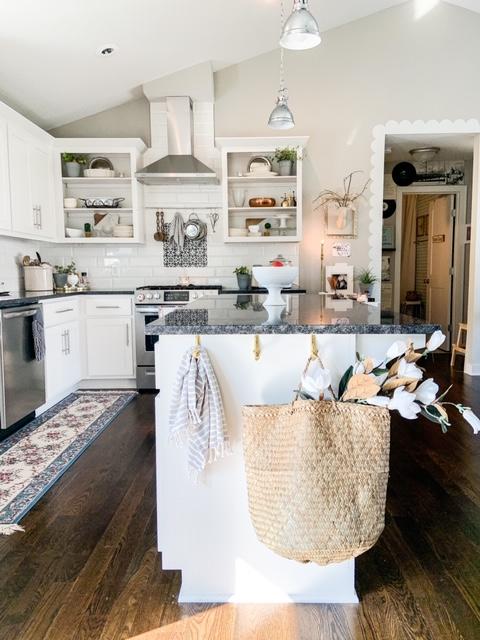 gold hooks on kitchen island