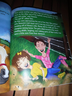 an illustration from Tawanda's Tales: Best Friends Forever depicts two girls laughing on the ground. One girl has short curly hair and yellow shirt and cowboy boots, while the other has straight hair in a ponytail and pink shirt and cowboy boots.