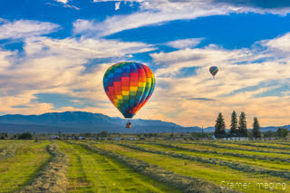 Cramer Imaging's fine art photograph of two hot air balloons taking flight in Panguitch Utah over a farm field and mountains