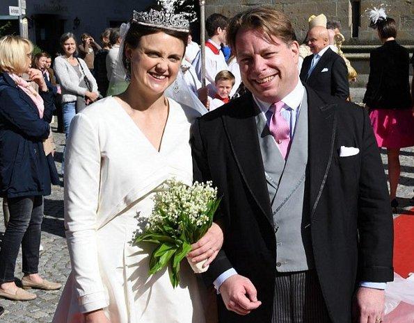 Grand Duchess Maria Teresa, Belgian Princess Astrid and her husband Prince Lorenz at wedding ceremony in Germany. wedding dress and tiara