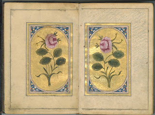 An open page showing two enclosed and illuminated illustrations of single roses.