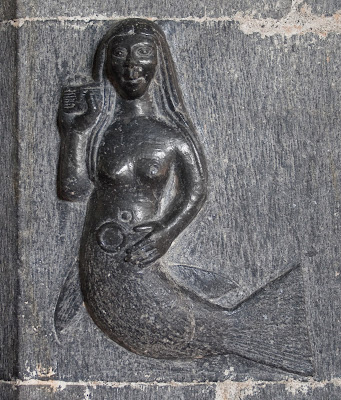 A15th-century carving of a mermaid with comb and mirror at the Clonfert Cathedral, Clonfert, County Galway, Ireland.