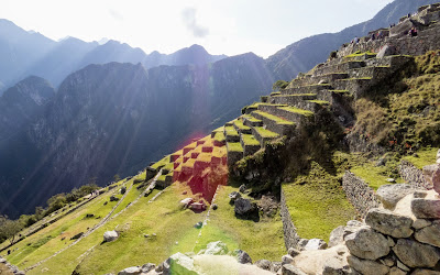 Machu Picchu Images: Picture of the sun rising over the terraced farms at Machu Picchu