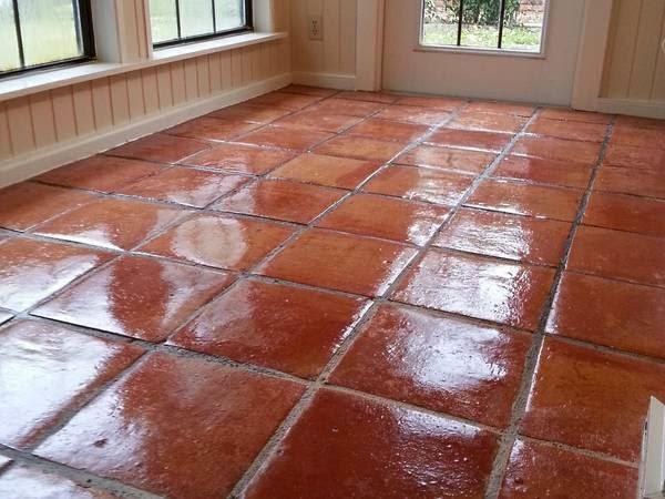 A living room spanish tile strip and wax job