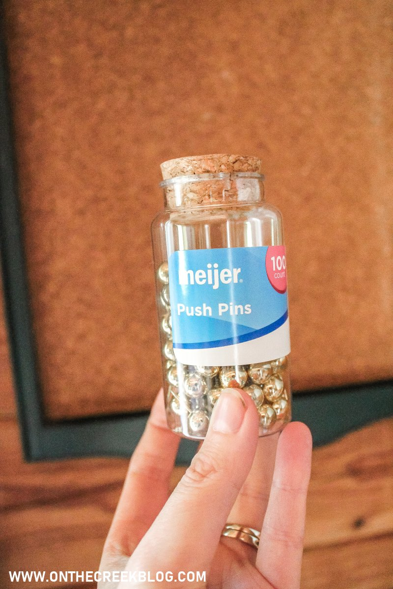 Super easy DIY bulletin/cork board using cork board roll! Gold push pins are from Meijer! | On The Creek Blog
