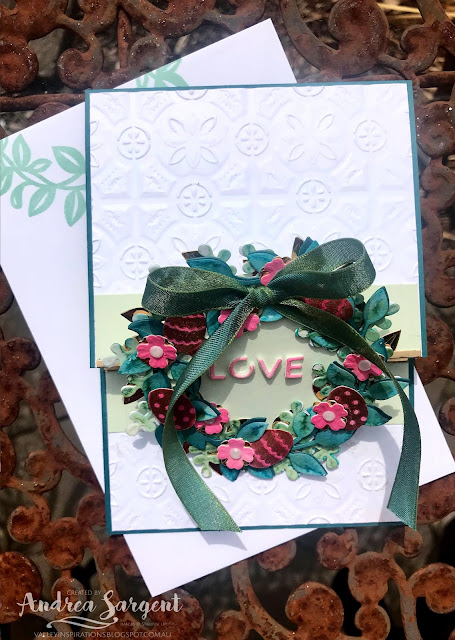 A card featuring a deep teal blue-green, Pretty Peacock, with water-coloured die cuts and dry embossing.