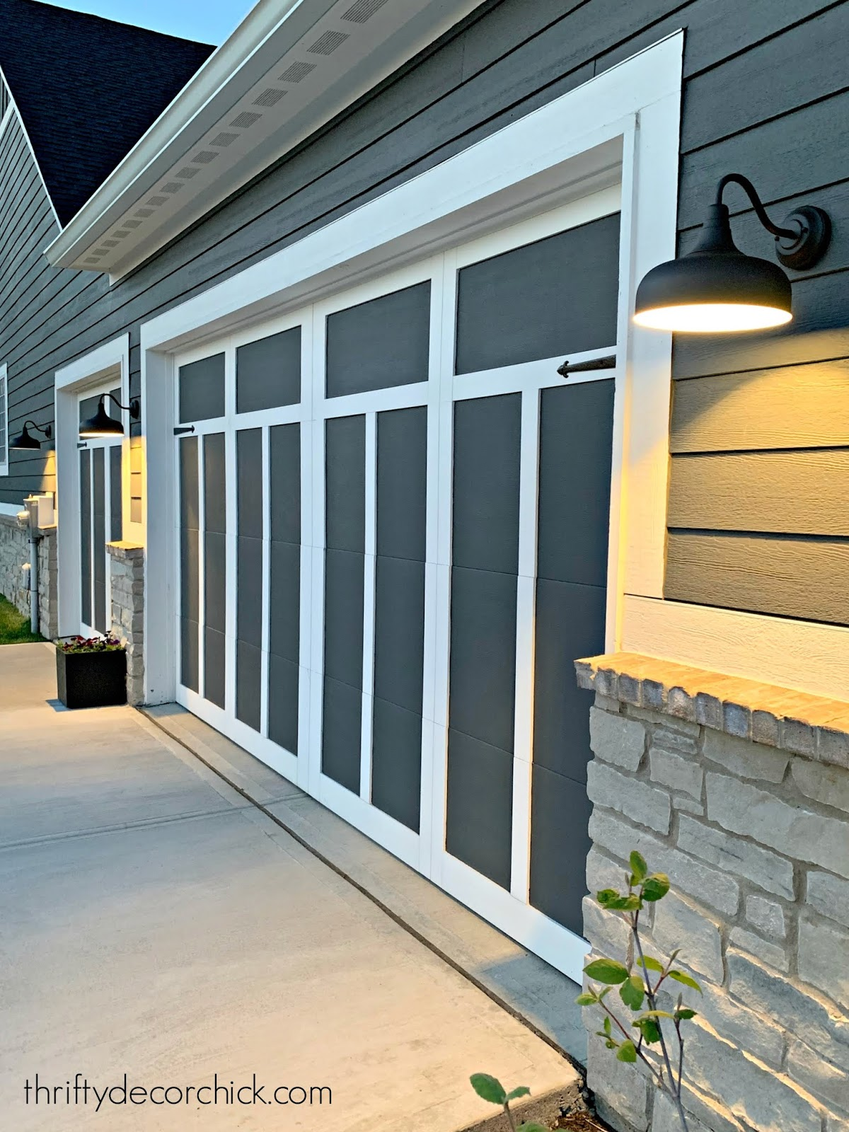 Modern Craftsman garage door and lighting design