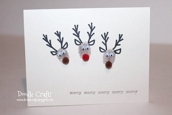Thumbprint reindeer with little pompom noses on greeting holiday Christmas cards, perfect for the holidays.