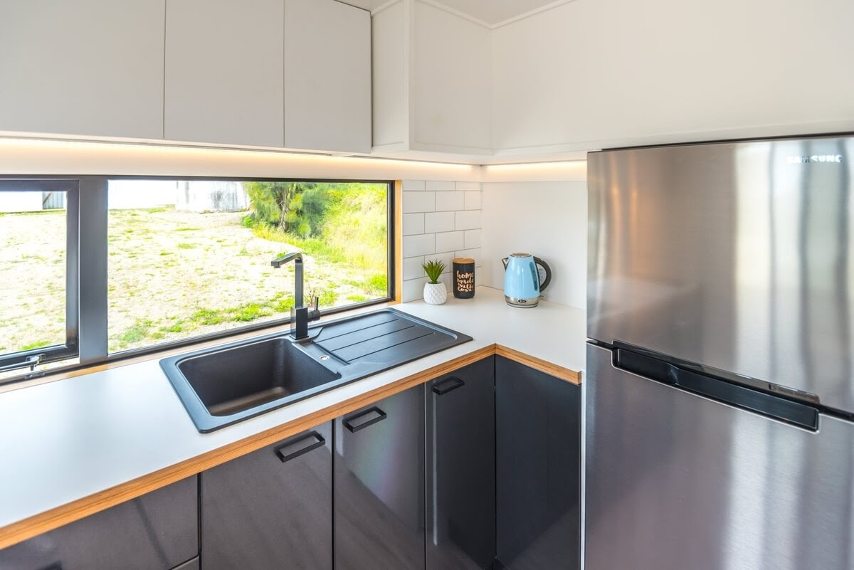 03-Kitchen-Architecture-with-the-Pohutukawa-Tiny-Home-Double-Mezzanine-www-designstack-co
