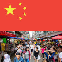 image of chinese flag and busy street in Hong Kong with dozens of shoppers