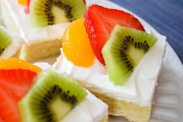 square of fruit pizza with mandarin orange, strawberry and kiwi