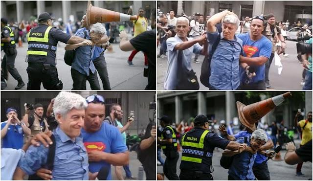 """Jornalista premiado e respeitado, Caco Barcellos, 66 anos, sentiu na pele a fúria popular contra a Rede Globo. Caco foi impedido nesta quarta-feira (16) de cobrir o ato de servidores estaduais próximo à Assembleia Legislativa do Rio de Janeiro. O apresentador do Profissão Repórter foi atingido na cabeça e nas costas por garrafas de água e cones de trânsito. """"Globo golpista"""" e """"O povo não é bobo, abaixo a Rede Globo"""" gritavam as dezenas de pessoas que o hostilizavam. Mais cedo, um jornalista do Jornal O Globo foi agredido por um dos manifestantes. Vestido com uma camisa azul, um homem tentou agredir o repórter, que mexia no celular e conseguiu se esquivar do soco. Ao correr, um outro manifestante deu um chute em sua perna. O repórter perdeu seus óculos."""