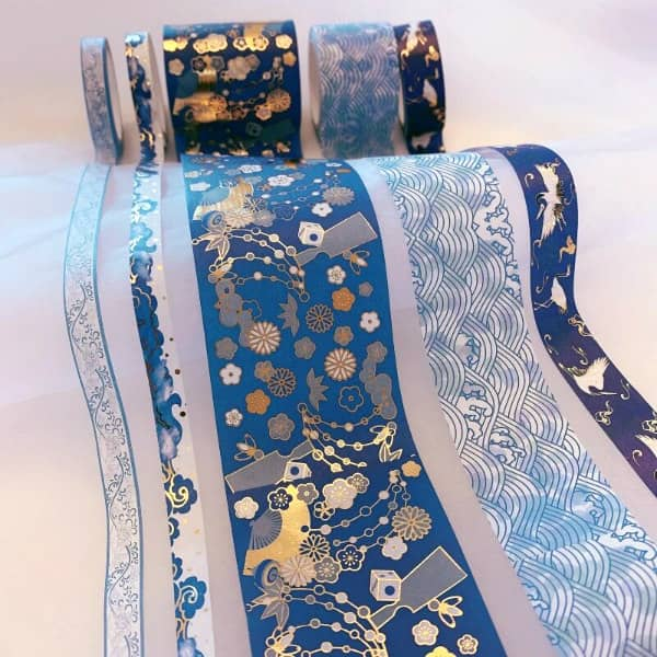unfurled rolls of washi tape in varied widths and patterns