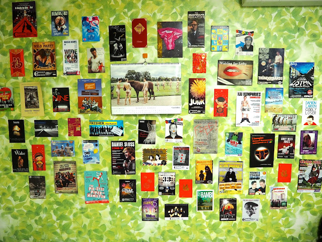 Wall decoration display, with calendar, Edinburgh Fringe flyers and Chinese red packets - inside studio apartment in Busan, South Korea