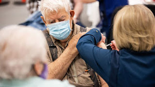 Aaron Dickey, 91, receives a COVID-19 vaccine while his wife, Marion, 83, left, looks on in Spanish Fork on March 25. Marion Dickey said she looked to President Russell M. Nelson of The Church of Jesus Christ of Latter-day Saints when deciding whether to get the vaccination.   Spenser Heaps, Deseret News