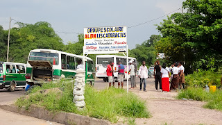 They are waiting for the bus to be repaired and continue to Brazzaville