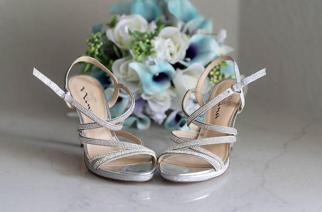 Bride's heels in front of bouquet detail shot