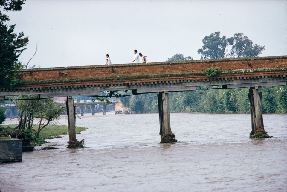 Old image of Traditional foot traffic bridge over the Bagmati River near the confluence with the Bishnumati River