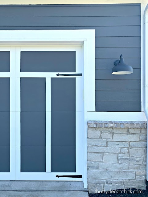 Dark gray and white garage doors with trim