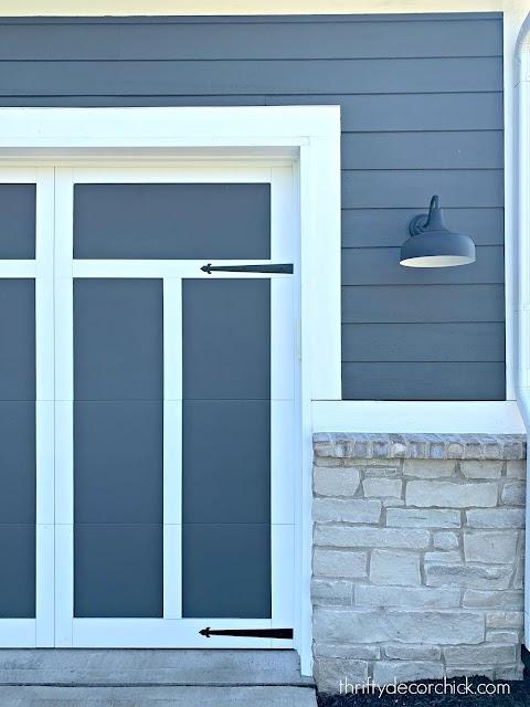 Dark gray and white garage doors with trim
