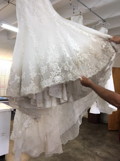 A lacier dresses hem before cleaning