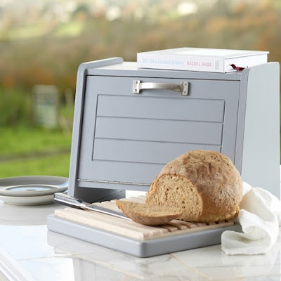 bread bin with space underneath for a bread board (shown with bread on it)