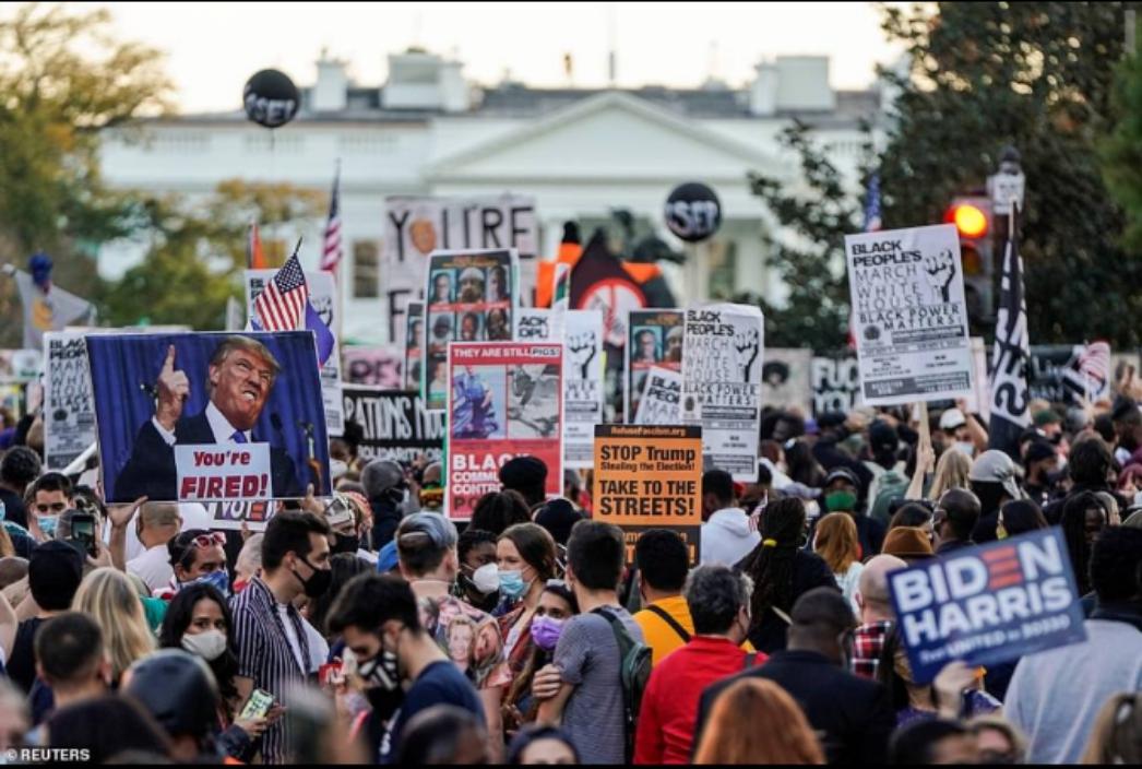 Magoya bayan Jeo Biden sun yi layi kan titunan DC a yayinda Trump yake komawa White House bayan ya kammala wasan golf