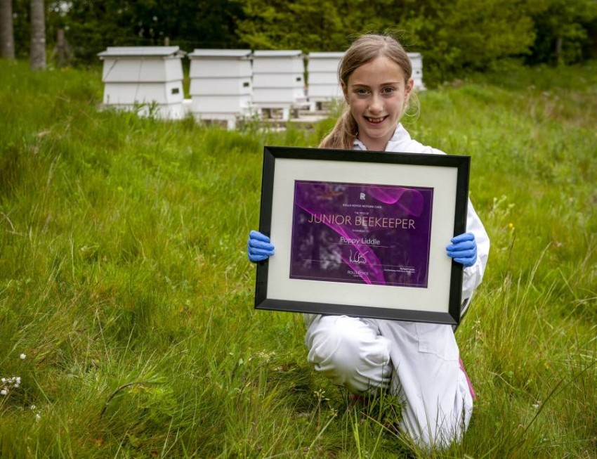 Rolls-Royce appoints Poppy Liddle, an eight-year-old girl, as a beekeeper