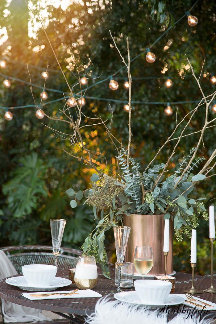 globe lights and eucalyptus table