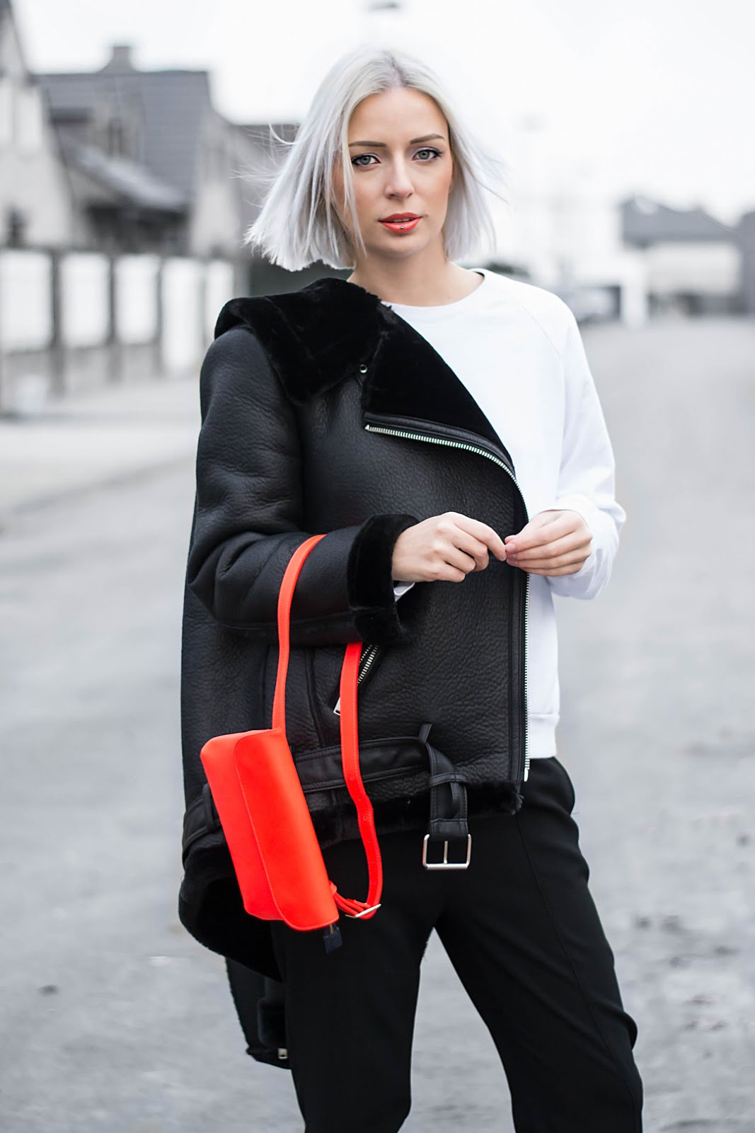 Black shearling jacket zara, Neon orange bumbag &otherstories, American apparel sweatshirt