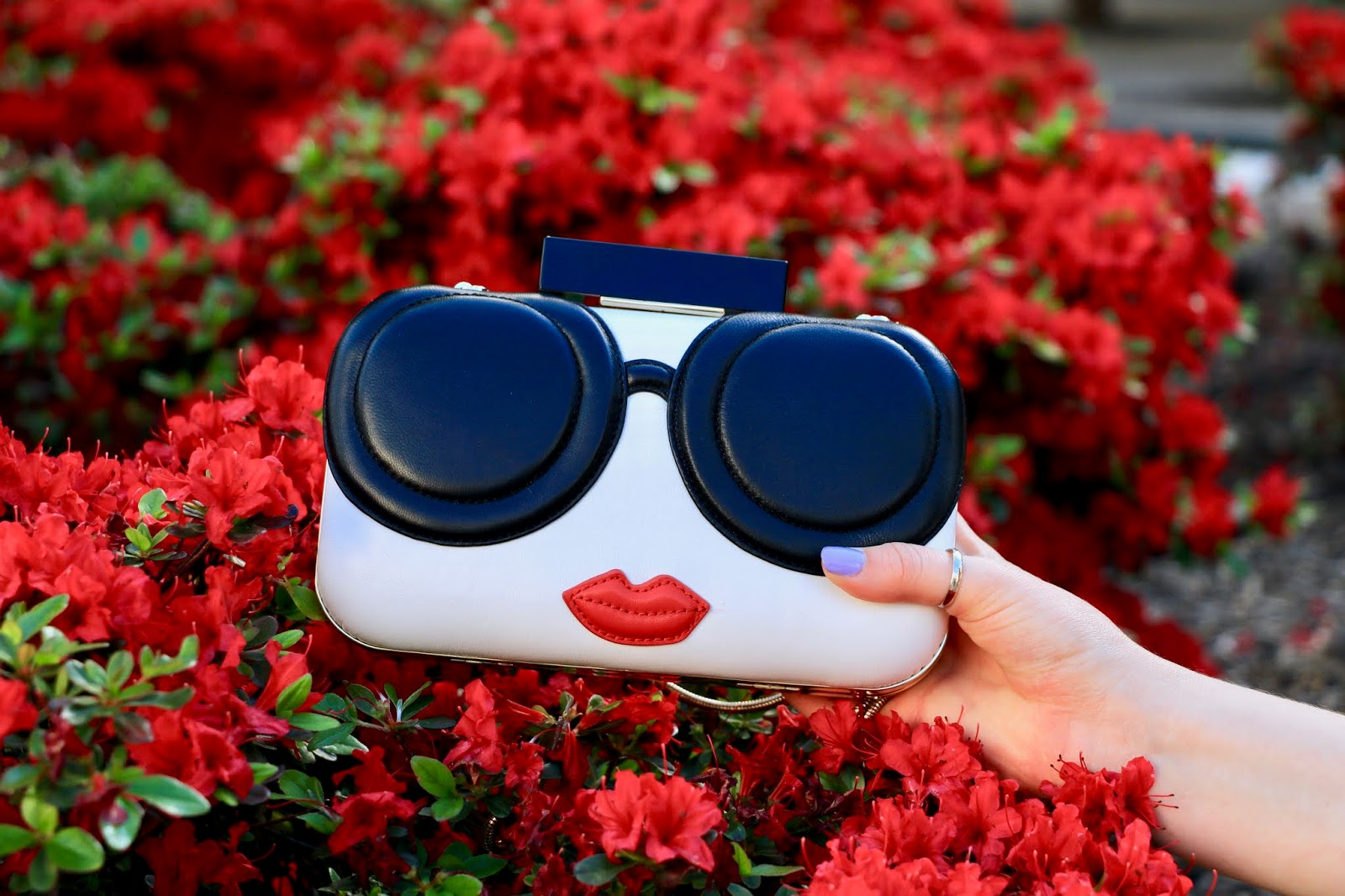 Nyc fashion blogger Kathleen Harper's Alice & Olivia face clutch.