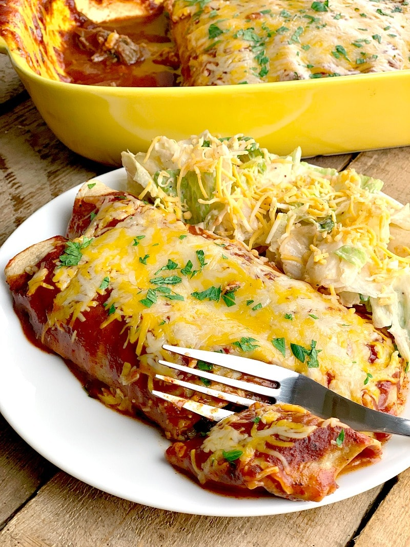 This low carb beef enchilada recipe is so easy to make! Utilizing tender shredded beef from the Instant Pot, it is seriously the BEST beef enchilada recipe you will ever try! #mexican #mexicanfood #mexicanrecipe #beef #enchiladas #keto #lowcarb #easy #mealprep #recipe | bobbiskozykitchen.com
