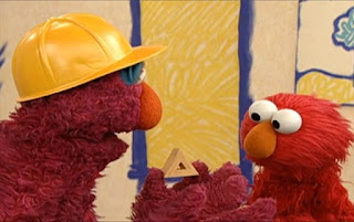 Telly presents a small wooden triangle. Elmo says it is a terrific triangle building. Sesame Street Elmo's World Building Things
