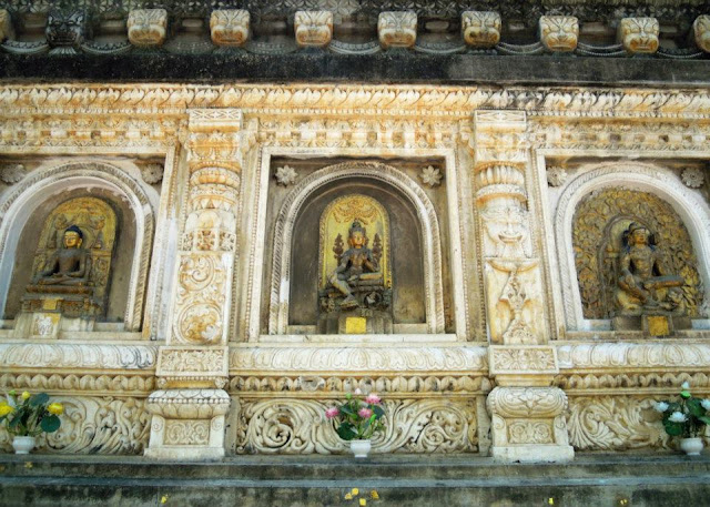 The temple wall of the Mahabodhi Temple, Bodhgaya, has many niches containing iconic representations of the Buddha and various Bodhisattvas.