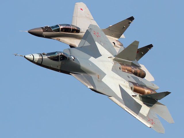 Sukhoi T-50 and Sukhoi Su-27 in One Frame