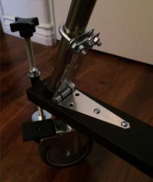 Using U-bolts and hinges in homemade design to keep telescope tripod legs in wheeley bars (Source: Palmia Observatory)