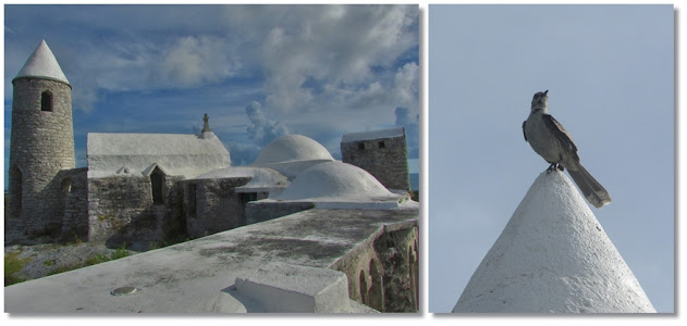 White rooftops of Mount Alvernia Hermitage under cloudy blue sky.
