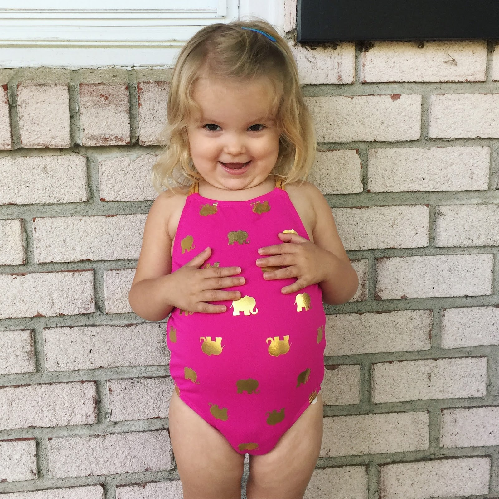 thoughts for friday designer bags and dirty diapers bloglovin another day another bathing suit i seriously have to make a photo album of just her bathing suit pics