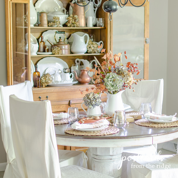 dining table with fall colors and slipcovered chairs