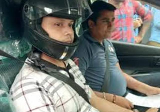 हेलमेट पहनकर कार चला रहा ये शख्स, जानिए वजह... - newsonfloor.com